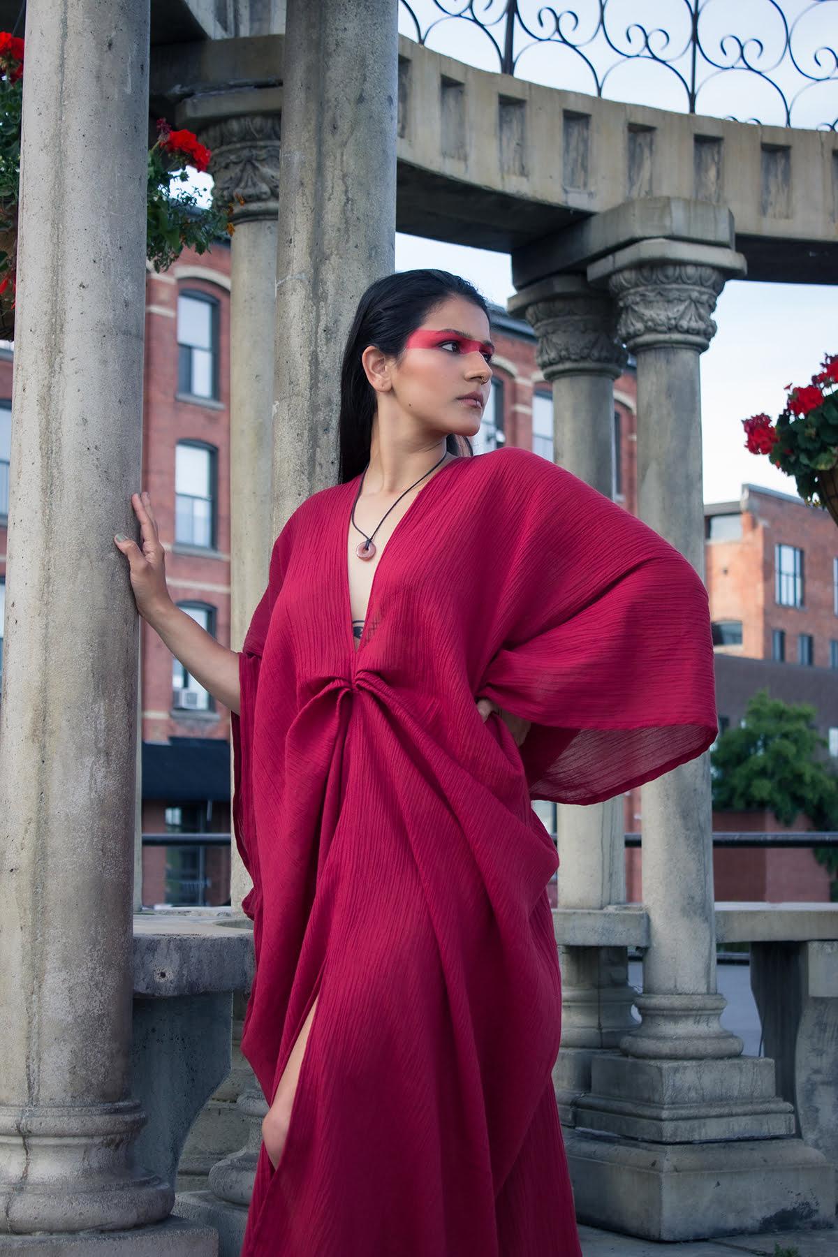 Woman wearing red organic cotton goddess red dress