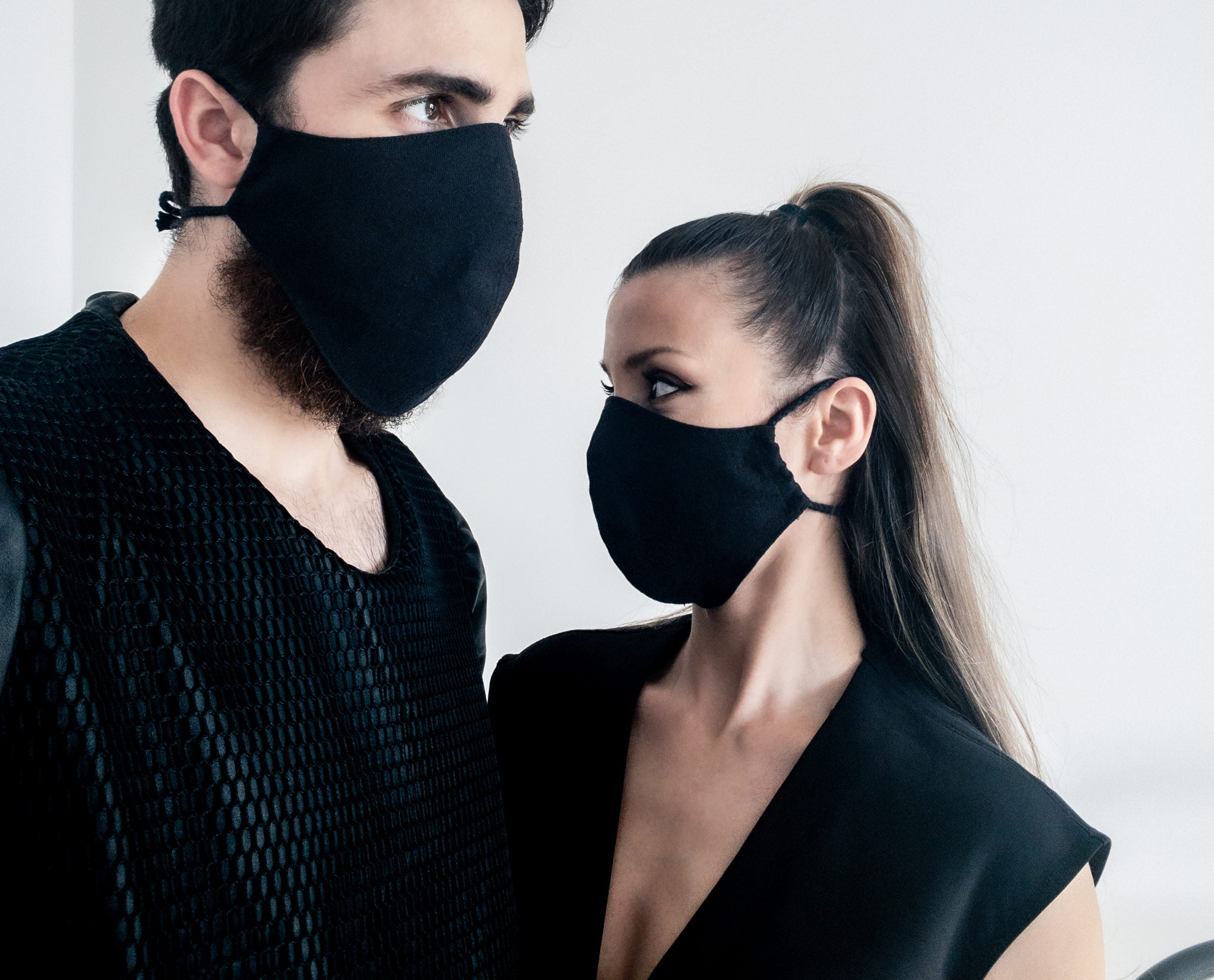 Man and woman waring organic black face masks