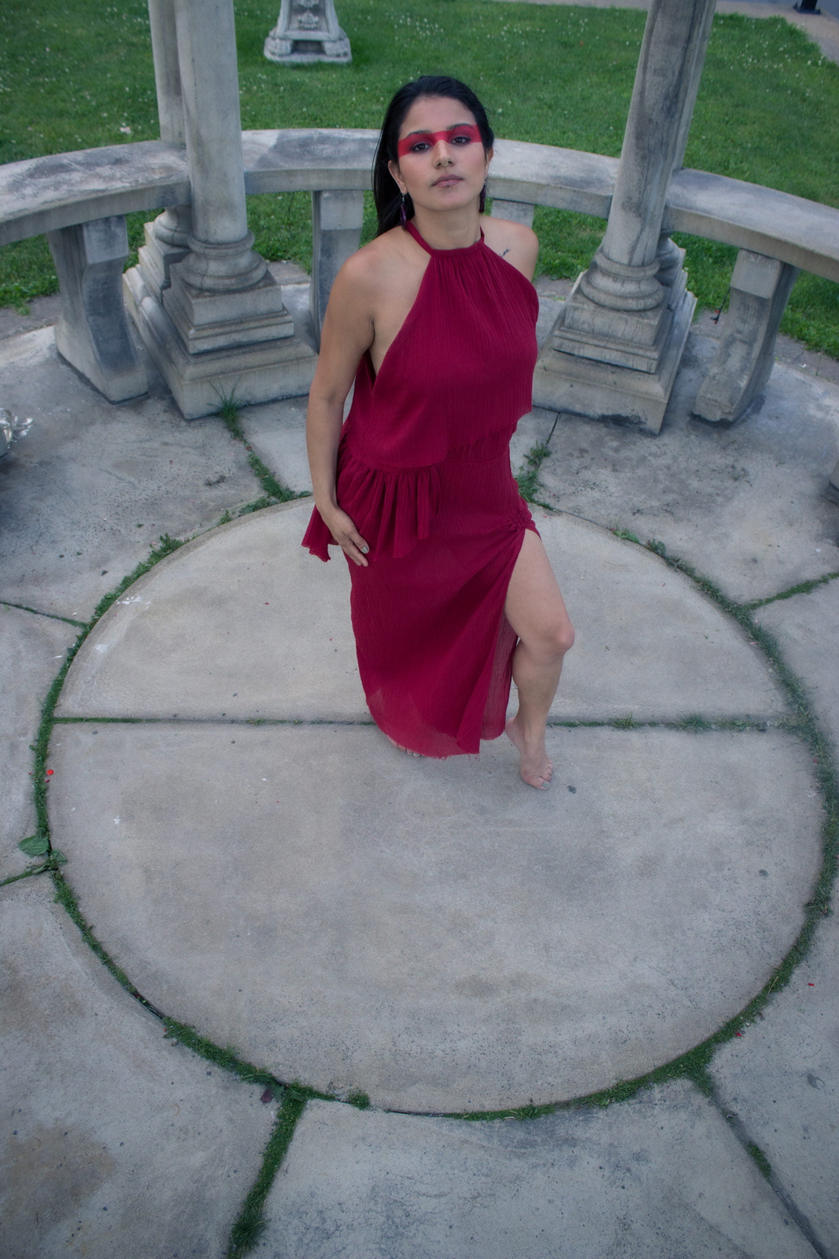 Woman wearing an organic red dress in a temple