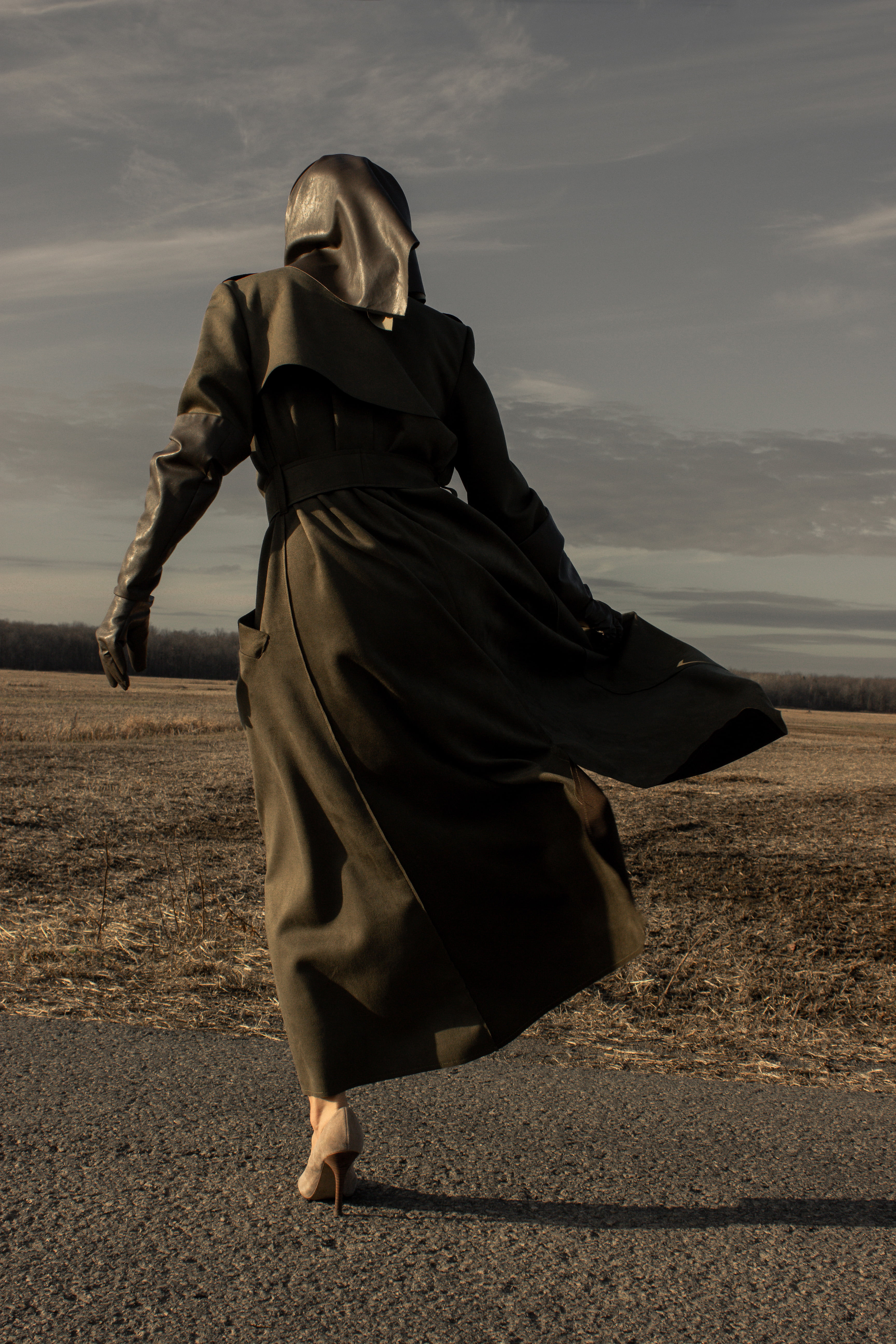 Model wearing vegan kaki green trench coat