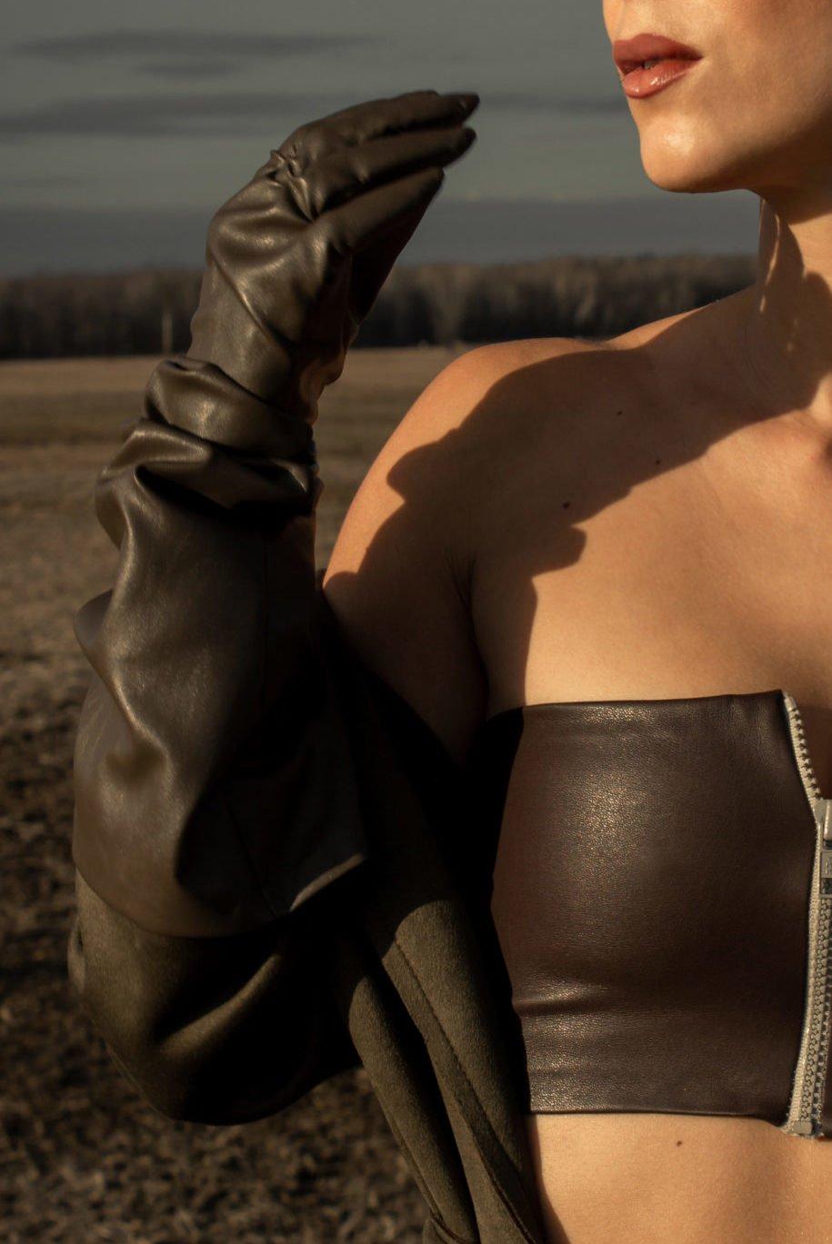 Woman wearing medieval faut leather gauntlet in cedar brown