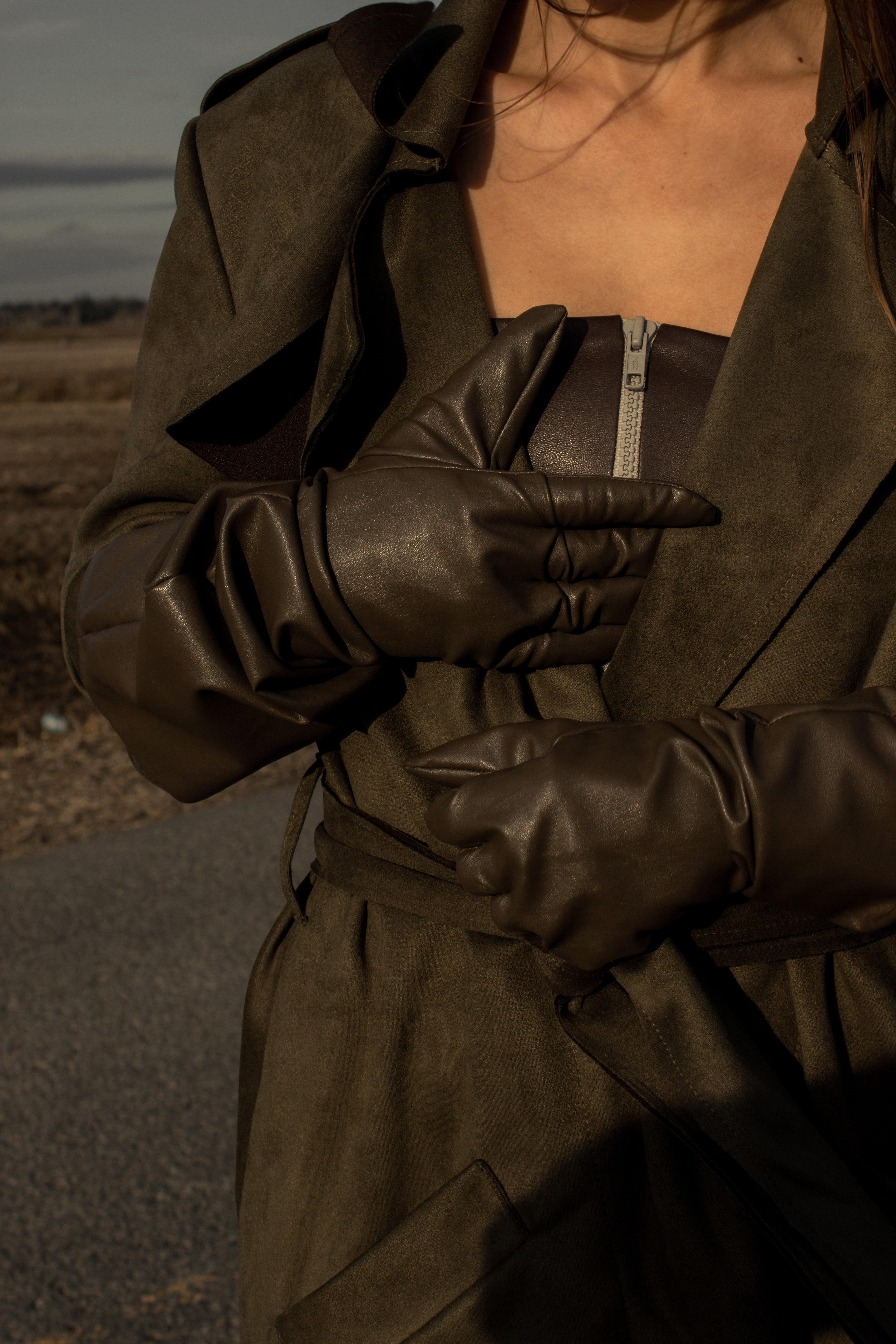 Woman wearing medieval faux leather gauntlet gloves in cedar brown