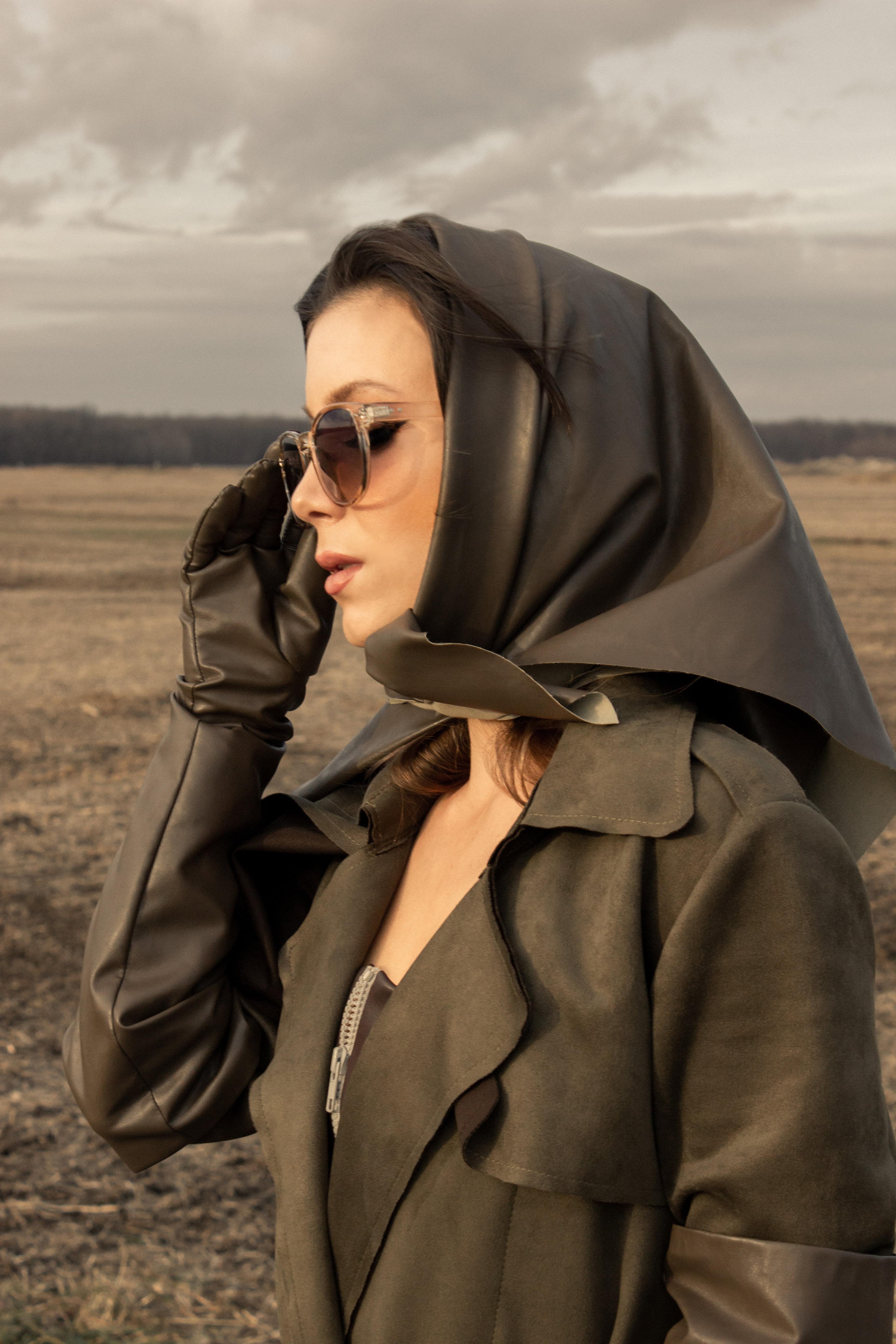 Woman wearing faux leather babushka head scarf in cedar brown
