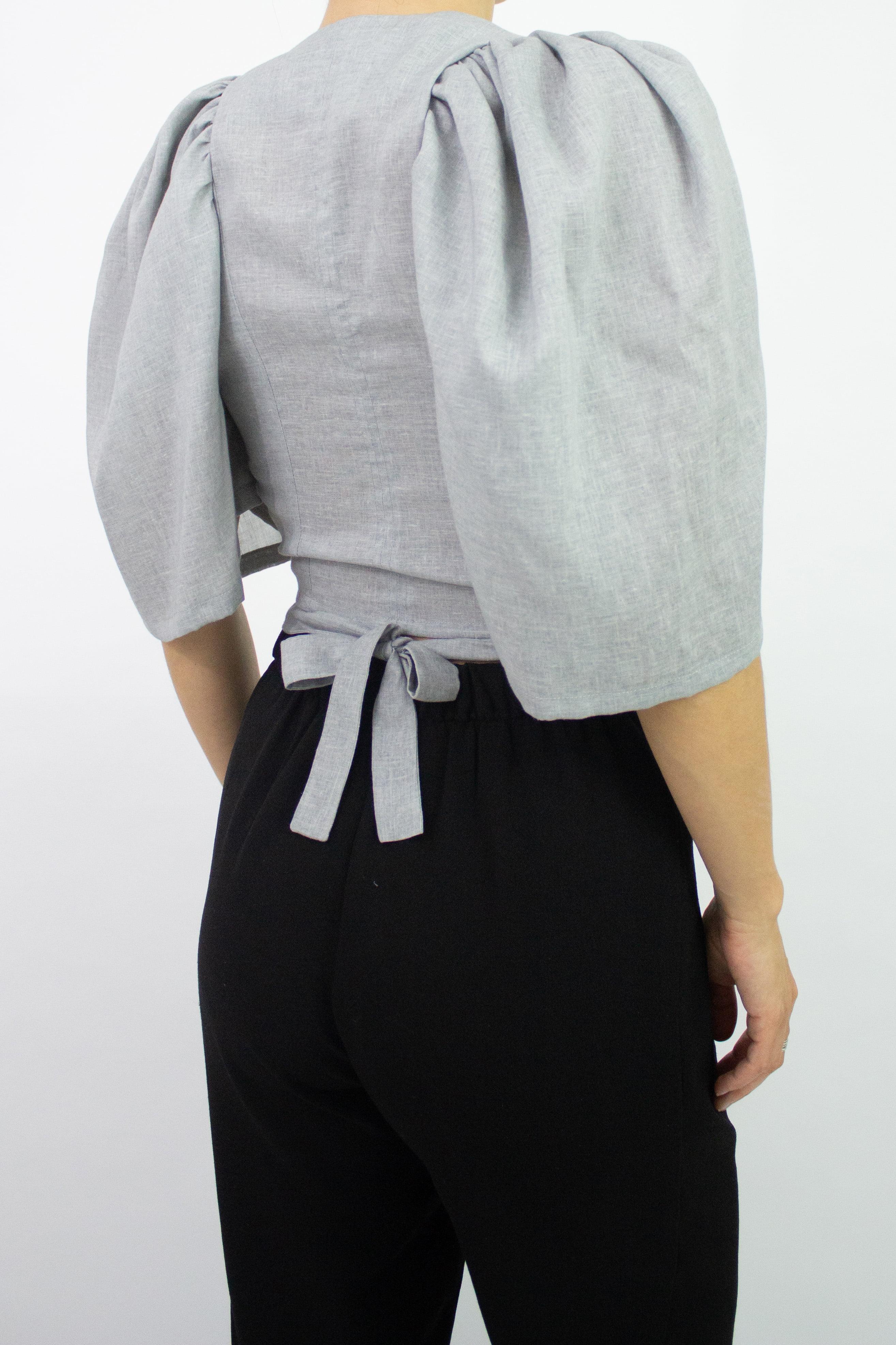 Woman wearing grey tie top