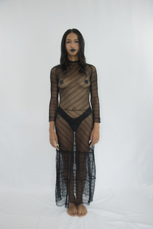 Woman wearing transparent long strech laced tiered dress