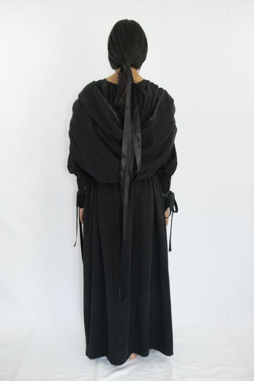 Woman wearing black tencel witch ritual summer dress