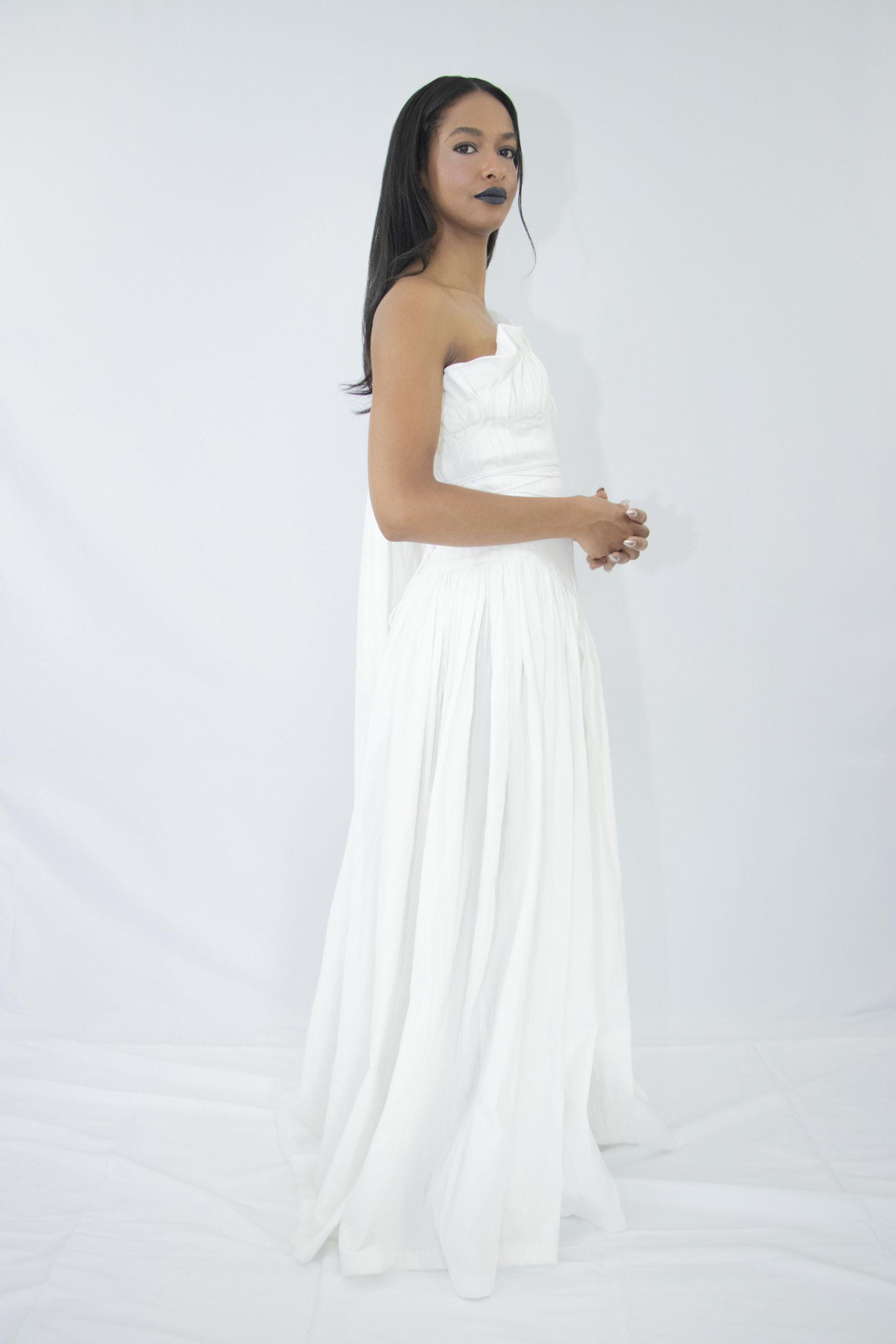 Woman wearing white organic cotton pleated wedding dress