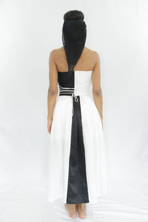 Woman wearing white and black tea-lenght linen pleated skirt