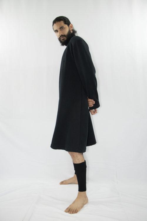 Man wearing organic long black unisex tunic with turtleneck and long sleeves